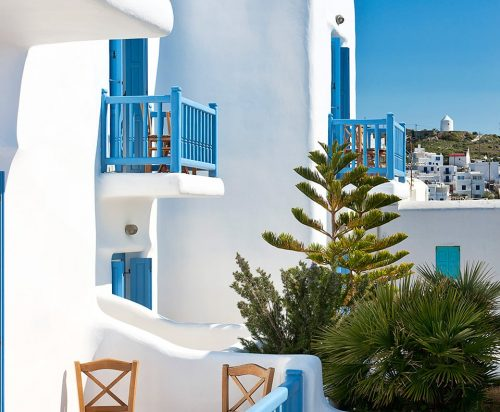 View of the exterior of Harmony Hotel in Mykonos town. Private balconies and plant in the garden.