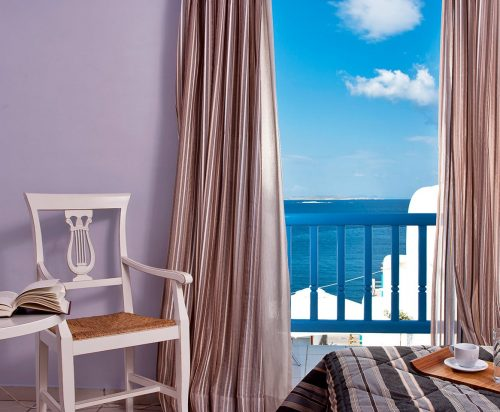 Chair by the open window with amazing sea view at Sea View Rooms at Harmony Boutique Hotel